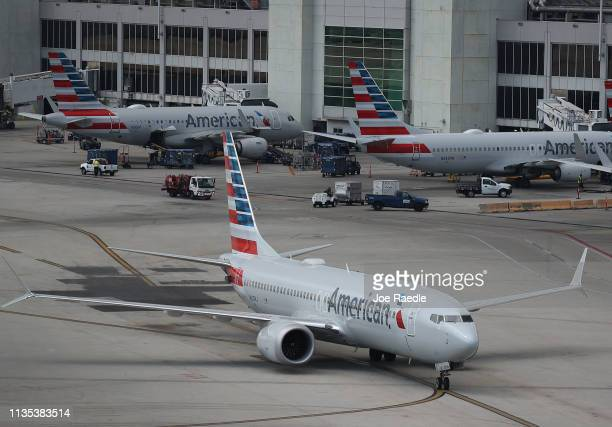 An American Airlines Boeing 737 Max 8 arriving from Washington's Ronald Reagan National Airport is seen taxiing to its gate at the Miami...
