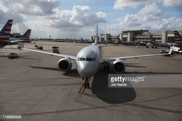 An American Airlines Boeing 737 Max 8 is seen as it pulls into its gate after arriving at the Miami International Airport from LaGuardia Airport on...