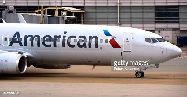 An American Airlines Boeing 737 passenger plane taxis from a gate to the runway at Ronald Reagan Washington National Airport in Washington DC