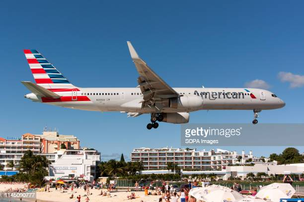 An American Airlines Boeing 757-200 seen landing at airport Princess Juliana just over Maho beach.