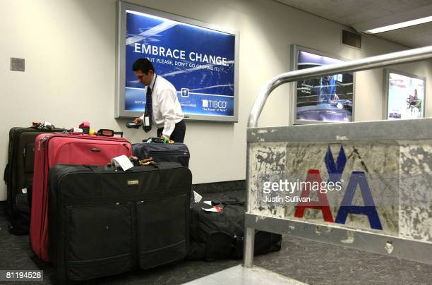 An American Airlines employee scans baggage May 21 2008 at San Francisco International Airport in San Francisco California American Airlines...