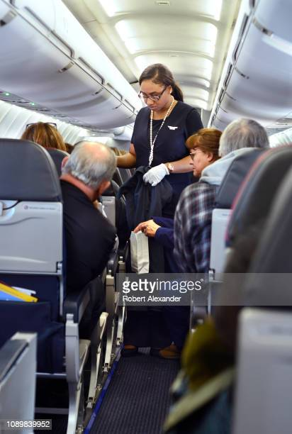 An American Airlines flight attendant assists a passenger who became airsick during a flight from San Antonio International Airport in Texas