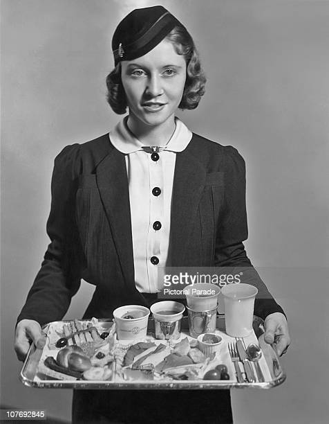 An American Airlines flight attendant with a tray of food circa 1935