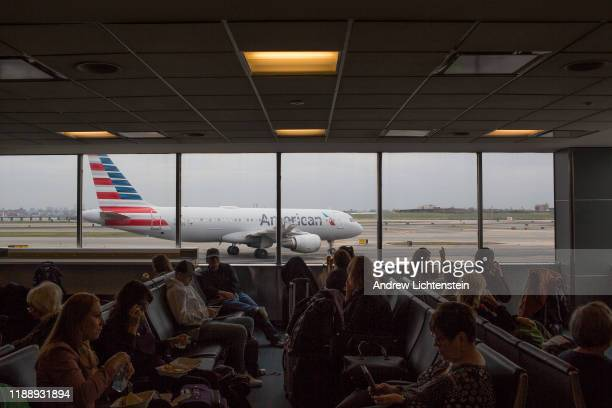 An American Airlines flight that has just landed taxis to a gate on November 7, 2019 at Terminal B in LaGuardia Airport in Queens, New York.