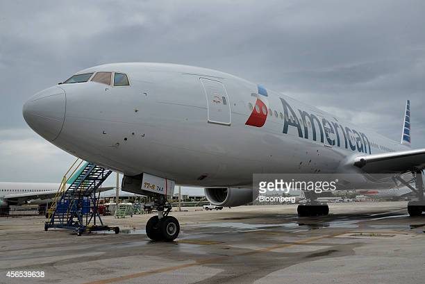 An American Airlines Group Inc jet sit parked at a terminal of Miami International Airport in Miami Florida US on Tuesday Sept 23 2014 American...