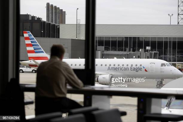 An American Airlines Group Inc plane sits on the tarmac during an event to mark the opening of five new gates inside Terminal 3 at O'Hare...
