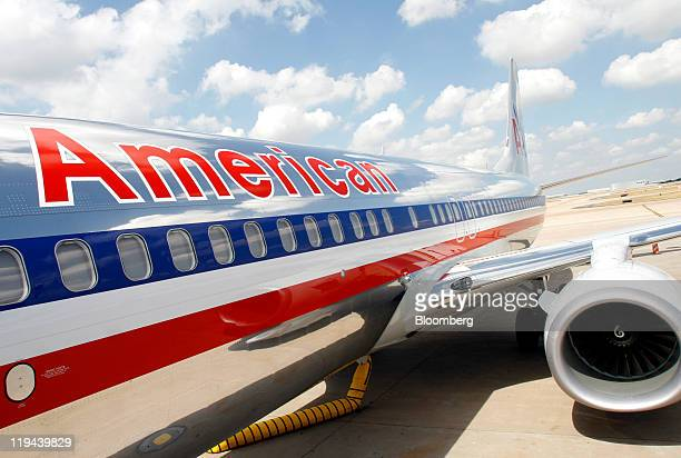 An American Airlines Inc jet sits on the tarmac at Dallas Fort Worth Internnational Airport in Fort Worth Texas US on Wednesday July 20 2011 AMR...