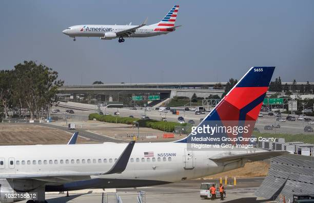 An American Airlines jet lands on runway 20R at John Wayne Airport in Santa Ana California on Wednesday September 6 2017