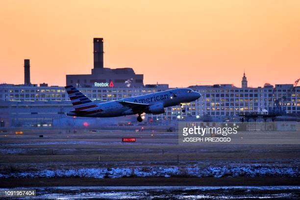An American Airlines jet takes off at Logan Airport in Boston Massachusetts on January 31 2019 on a day where over 2000 flights were cancelled and...