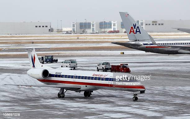 An American Airlines jet taxis to a gate after an overnight ice storm forced the closure of DFW International Airport on February 1 2011 in Dallas...