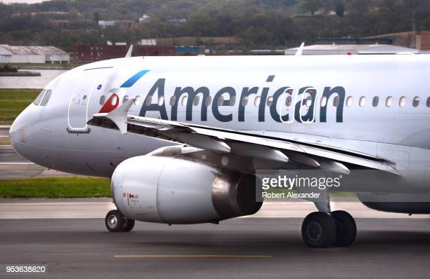 An American Airlines jet taxis to the runway as an American Eagle jets lands at Ronald Reagan Washington National Airport in Washington DC