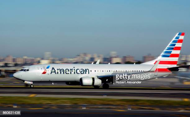 An American Airlines passenger jet lands at LaGuardia Airport in New York, New York.