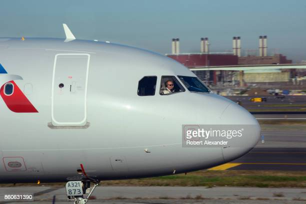 An American Airlines passenger jet taxis at LaGuardia Airport in New York New York