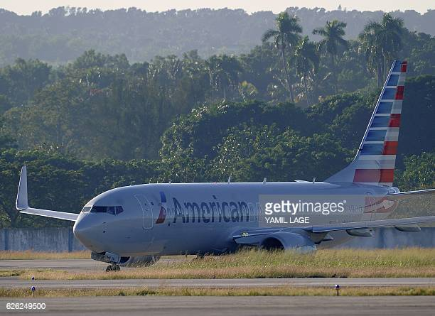 An American Airlines plane arrives at Jose Marti International Airport becoming the first Miami-Havana commercial flight in 50 years, coinciding with...