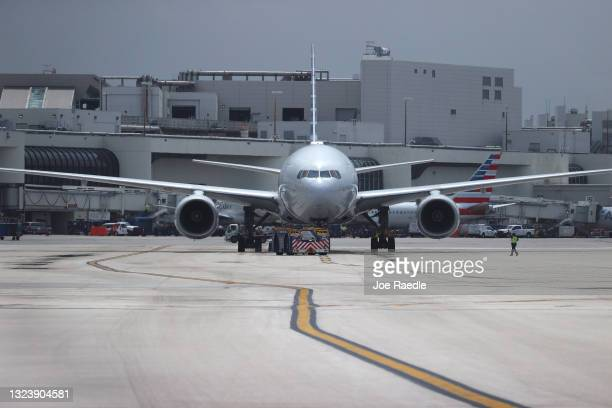 An American Airlines plane is prepared for takeoff at the Miami International Airport on June 16, 2021 in Miami, Florida. Miami International...