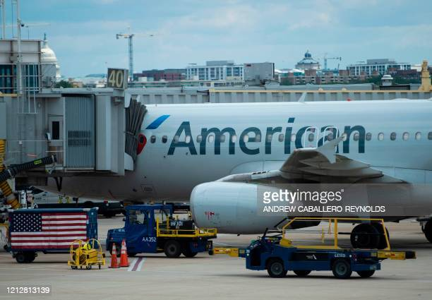An American Airlines plane is seen at a gate at Ronald Reagan Washington National Airport in Arlington Virginia on May 12 2020 The airline industry...