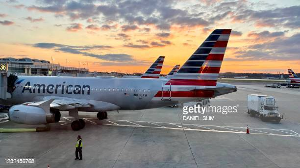 An American Airlines plane is seen at sunrise on the tarmac of the Reagan Washington National Airport in Arlington, Virginia, on April 22, 2021.