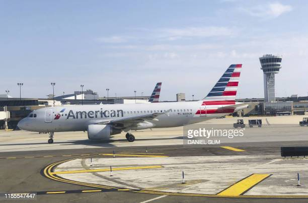 An American Airlines plane is seen on the tarmac on July 14, 2019 at Philadelphia International Airport in Philadelphia, Pennsylvania.