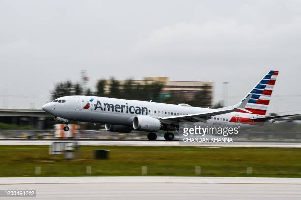 An American Airlines plane lands at the Miami International Airport in Miami, on June 16, 2021.
