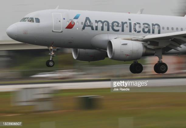 An American Airlines plane lands at the Miami International Airport on June 16, 2021 in Miami, Florida. Miami International Airport, founded in 1928,...