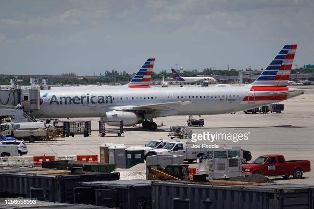 An American Airlines plane parks at a gate in the Fort Lauderdale-Hollywood International Airport on July 16, 2020 in Fort Lauderdale, Florida....