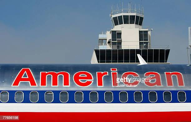 An American Airlines plane parks at the termial after arriving at the Oakland International Airport November 2 2007 in Oakland California American...