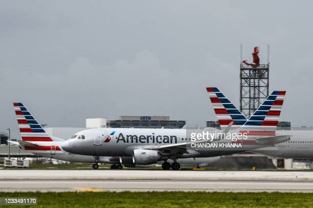 An American Airlines plane prepares to take off from the Miami International Airport in Miami, on June 16, 2021.
