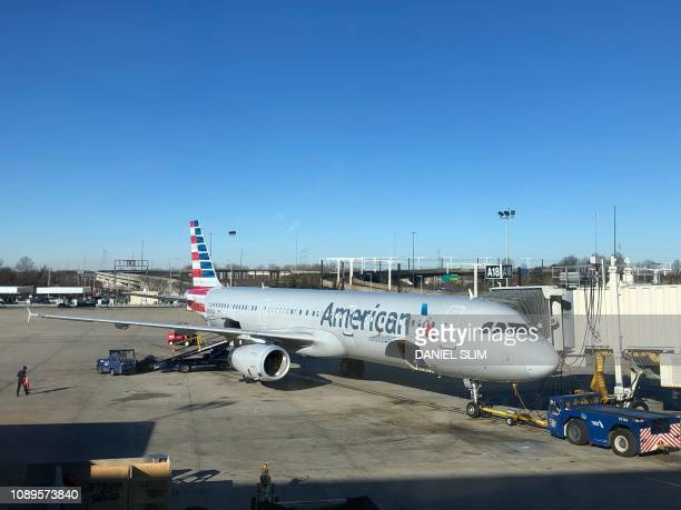 An American Airlines plane sits at the gate on January 22 at Philadelphia International Airport