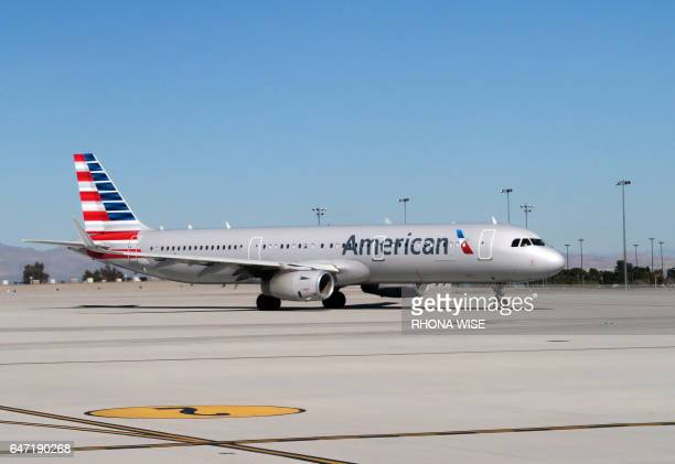 An American Airlines plane sits on the tarmac of McCarran International Airport in Las Vegas Nevada on February 15 2017 / AFP PHOTO / RHONA WISE