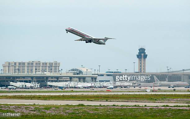 An American Airlines plane takes off at DallasFort Worth International Airport in Irving Texas US on Wednesday April 20 2011 American Airlines parent...