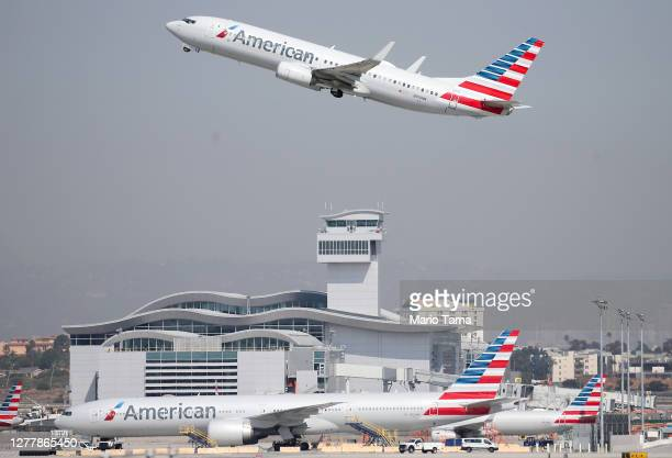 An American Airlines plane takes off from Los Angeles International Airport on October 1, 2020 in Los Angeles, California. United Airlines and...