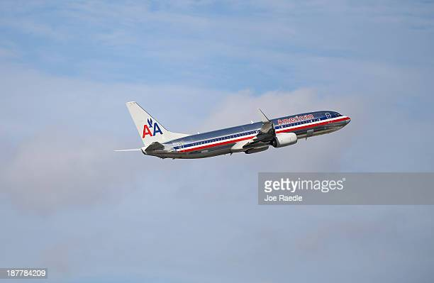 An American Airlines plane takes off from the Miami International Airport on November 12 2013 in Miami Florida Today the Justice Department announced...