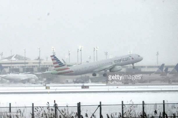 An American Airlines plane takes off under severe weather conditions from Newark International Airport on March 2 2019