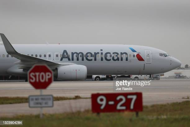 An American Airlines plane taxis after landing on the runway at the Miami International Airport on June 16, 2021 in Miami, Florida. Miami...