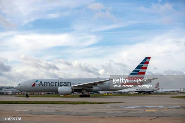 An American Airlines plane taxis to the southern runway at Heathrow Airport in West London