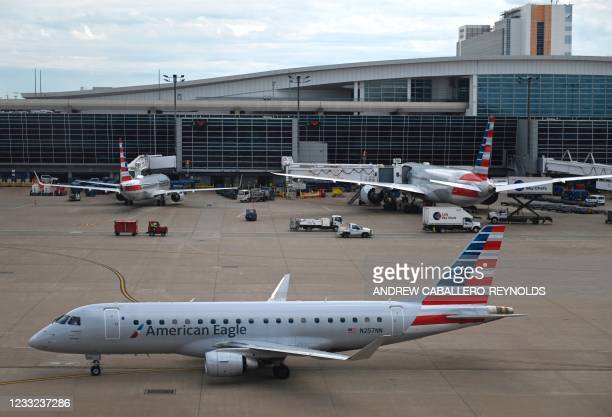 An American Airlines regional flight Embraer 175 is seen at the Dallas/Fort Worth International airport in Dallas, Texas on June 2, 2021.