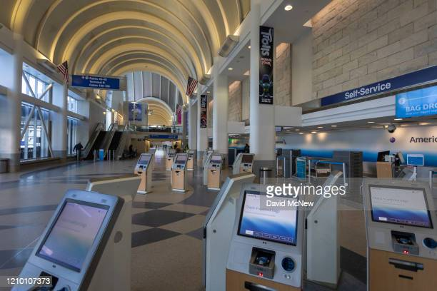 An American Airlines selfservice ticketing area stands vacant at a nearly deserted Los Angeles International Airport due to the coronavirus pandemic...