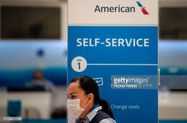 An American Airlines staffer waits for customers at the Benito Juarez International airport in Mexico City on May 20 amid the new Covid19 coronavirus...