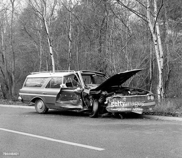 An American AMC Rambler car after a road accident in rural Surrey UK January 1964