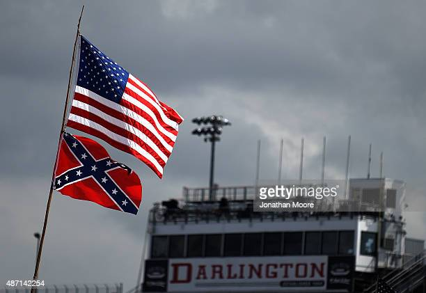 An American and a Confederate flag are seen flying over the infield campground prior to the NASCAR Sprint Cup Series Bojangles' Southern 500 at...