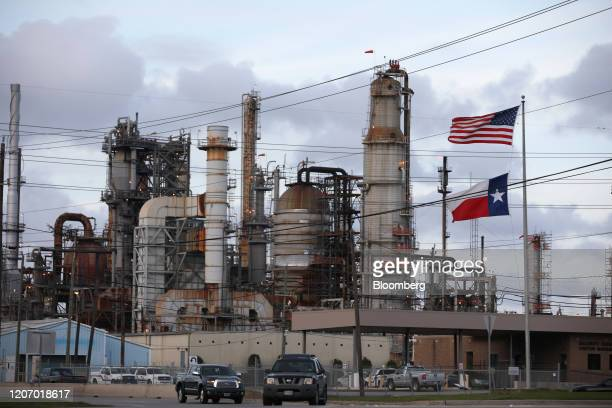An American and Texas flag stand in front of the Chevron Corp. Pasadena Refinery in Pasadena, Texas, U.S., on Sunday, March 8, 2020. Houston has been...