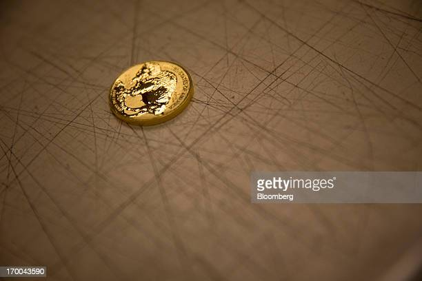 An American Buffalo gold bullion coin sits on a table at the United States Mint at West Point in West Point New York US on Wednesday June 5 2013...