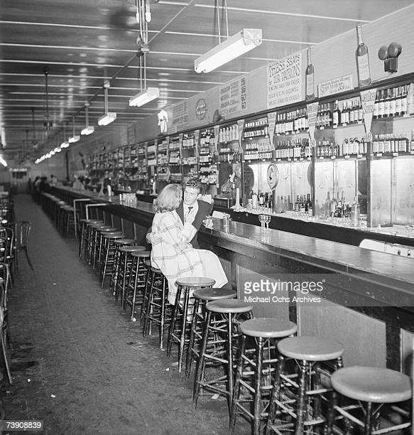 An American couple have a drink at The Aloha Cantina nightclub on September 22 1949 in Tijuana Mexico