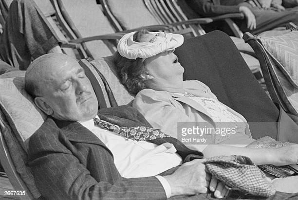An American couple sleeping in the Atlantic sunlight on board the Cunard liner Queen Elizabeth as she makes her way to Britain America wants to see...