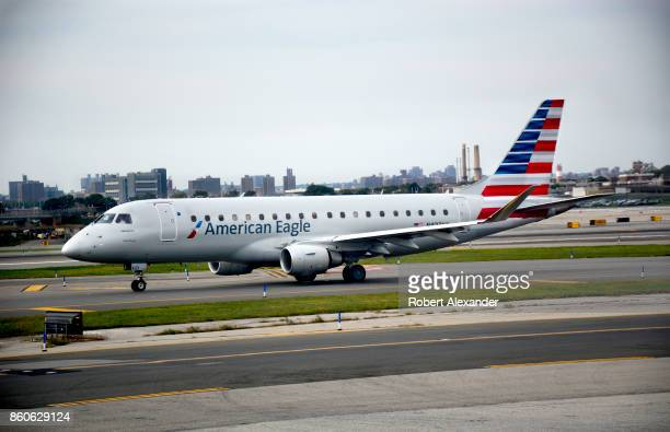 An American Eagle passenger jet taxis at LaGuardia Airport in New York New York