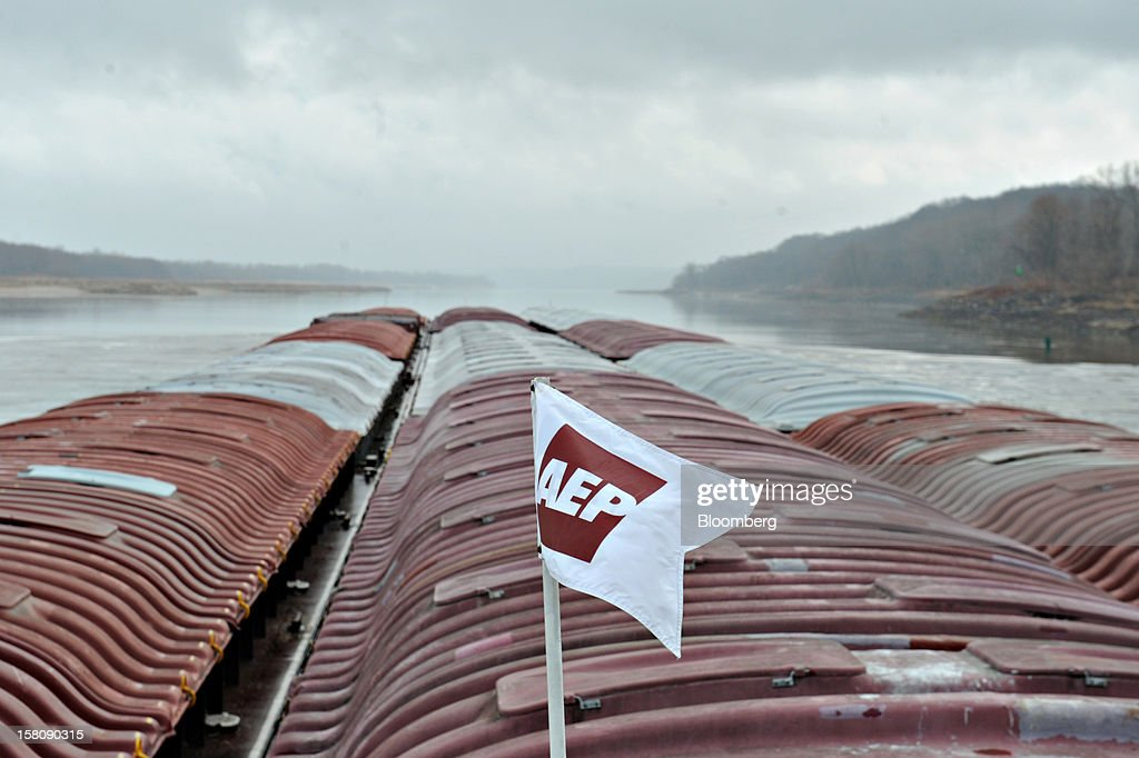 An American Electric Power (AEP) River Operations flag flies as the Capt. Bill Stewart tow boat pushes grain barges on the Mississippi River outside St. Louis, Missouri, U.S., on Friday, Dec. 7, 2012. Barges carrying grain, soybeans, coal, oil and other commodities on the Mississippi River have started to reduce their loads to navigate waters shrunk by the worst drought in 50 years. Photographer: Daniel Acker/Bloomberg via Getty Images