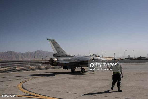 An American F16 fighter jet taxis down a runway at Bagram Air Field on September 5 2017 in Bagram Afghanistan Currently the United States has about...