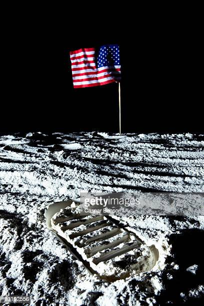 An American flag and footprint on the moon
