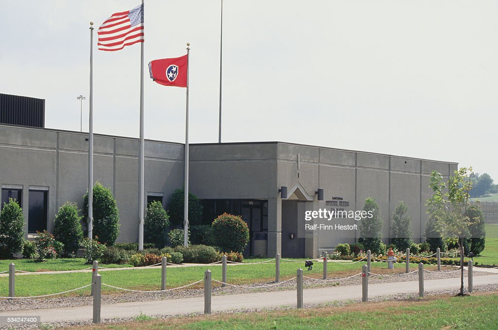 An American Flag And The Flag Of Tennessee Fly Outside The Lois M