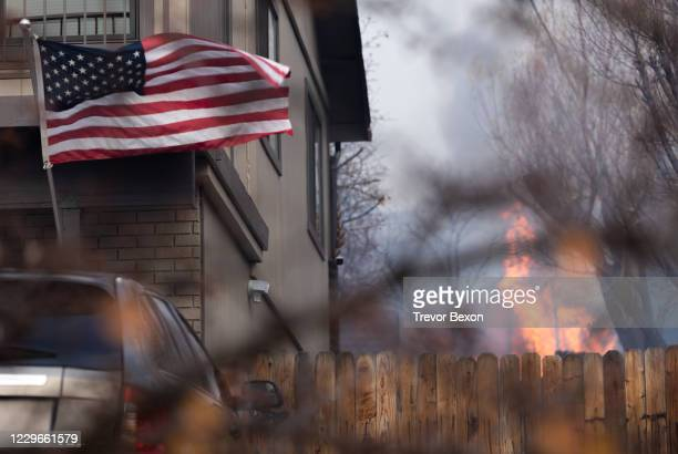 An American Flag blows in the high winds that spread a wildfire into residential neighborhoods on November 17, 2020 in Reno, Nevada. The Pinehaven...